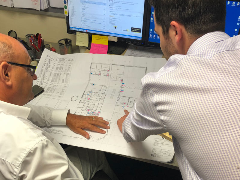 Two people looking at architectural plans
